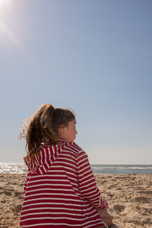 10 years old: Young girl, 10 years old, on the beach