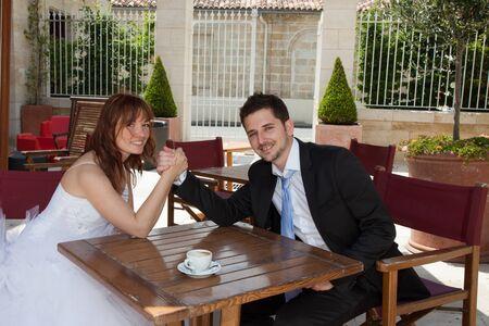 newly married couple: Newly married couple looking at the camera