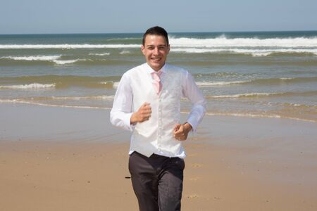 runing: A beautiful and elegant groom runing at the beach