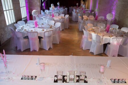 reception table: Banquet wedding table setting on evening reception