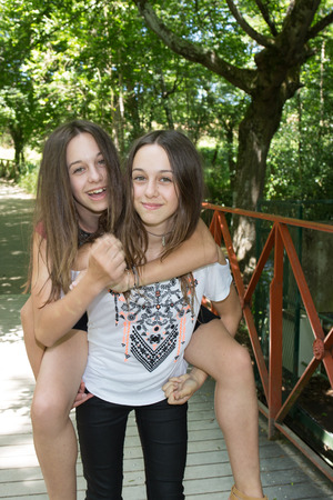 happy teenagers: Pretty and lovely teenager  at the park Stock Photo