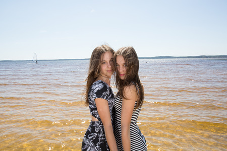 complicity: Complicity of two sisters in the summer outside Stock Photo