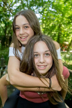 complicity: complicity of two sisters in the summer outside