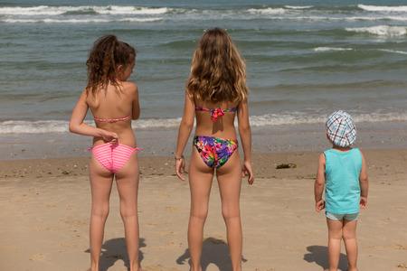 Back view of a happy children on beach Foto de archivo