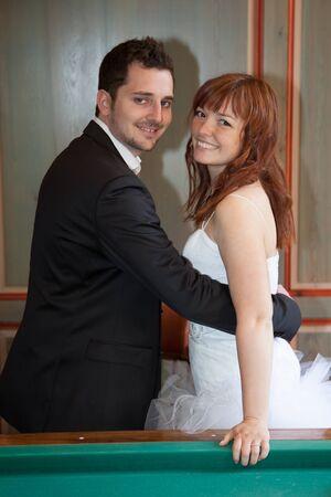a newly married couple: Newly married couple next to a billiard