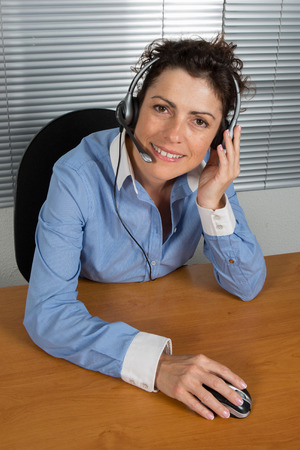 buisness woman: Smiling and happy businesswoman in a call center office