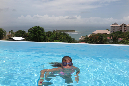 10 years: Girl 10 years old with goggles in swimming pool