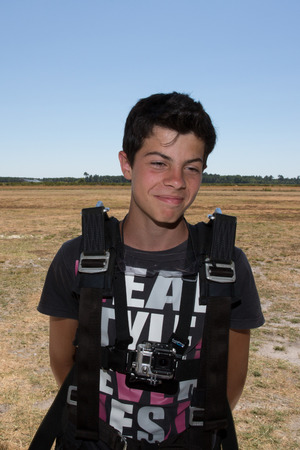go for: Young Teenager happy outdoors ready to go for skydiving