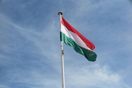 hungarian: Hungarian  flag against blue sky