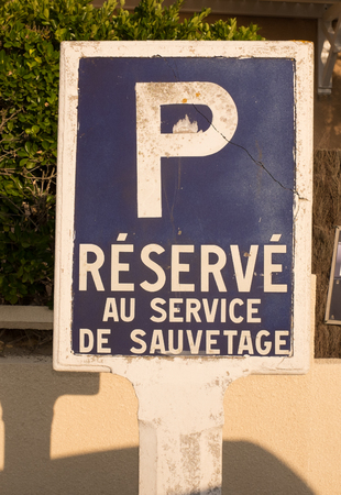 public service: Public service sign at hospital - Parking reserved