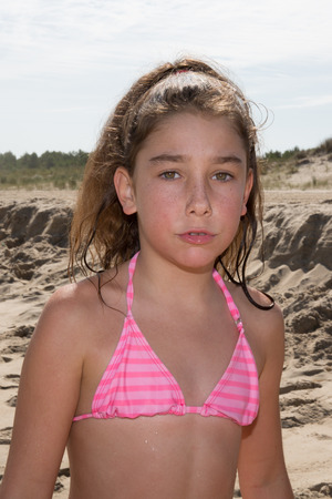 swim suit: Young girl, 10, at the beach on the ocean