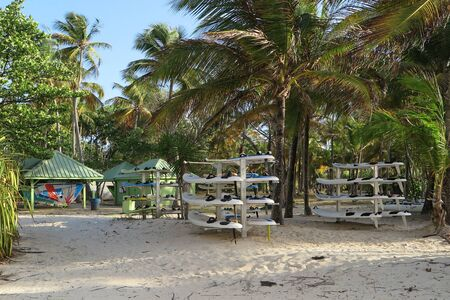 sail board: Surf-station on the beach - board storage and sail storage Stock Photo