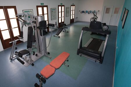 excersise: Interior view of a gym with equipment. Stock Photo