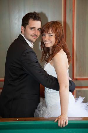 newly married couple: Newly married couple next to a billiard