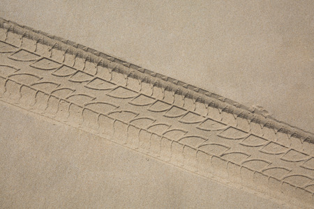 tyre tread: The trace of a tyre in the sand on the beach...