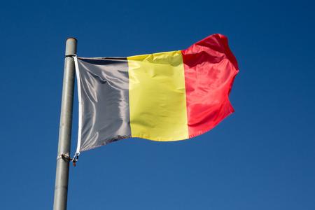 belgium: Belgium flag under blue sky