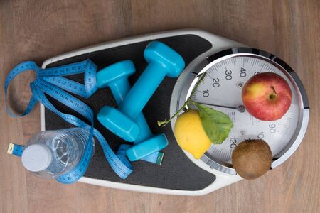 weight control: To control the weight , scale , water, fruits and sport Stock Photo