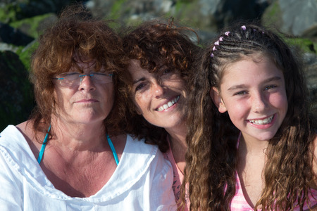 grand daughter: Three women, grand mother, mother and daughter have fun Stock Photo
