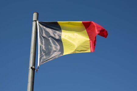 belgien: Belgium flag under blue sky