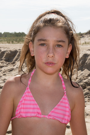 bathing suits: Young girl, 10, at the beach on the ocean