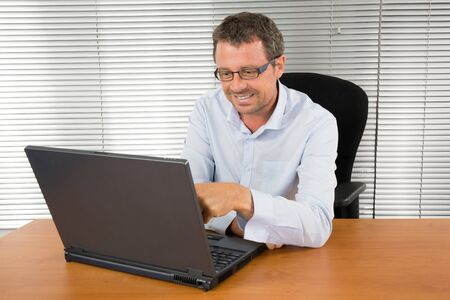 workteam: Businessman works on his computer on workplace