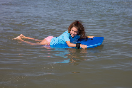bodyboarding: Young girl surfing with her board