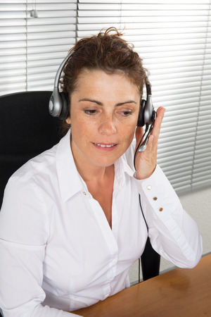 earing: Office girl happy at desk with headphone