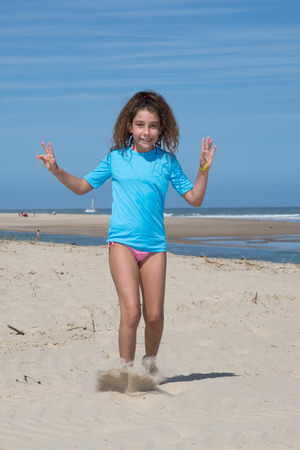 have on: On the beach sweet girl have fun