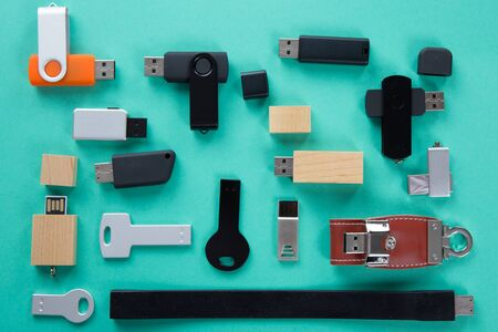 memory stick: Row of color USB flash drives on green background