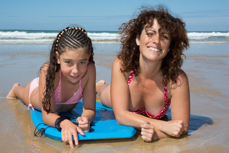 mum and child: Woman and her daughter happy on the beach