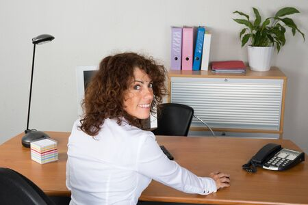 buisness woman: Woman at work with a white shirt happy to work