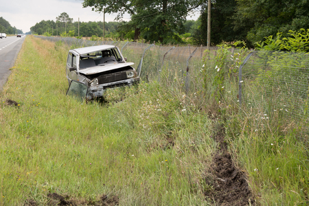 ditch: Accident - Car in a ditch on the grass