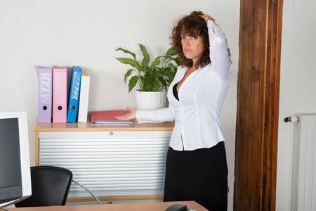 buisness woman: Woman at work not happy to work Stock Photo