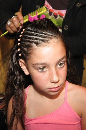 black hairs: Girl at the hair dresser Stock Photo