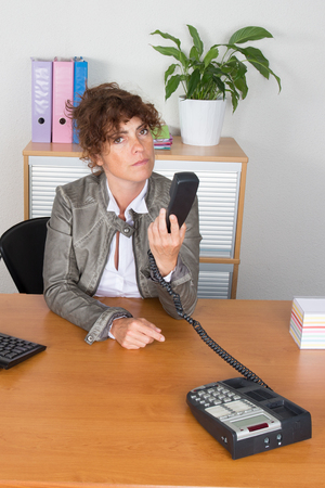 entrepeneur: Very lovely middle age business woman at office