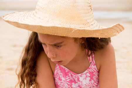 oceanfront: Adorable little girl at beach on summer vacation