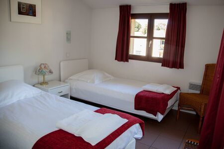 cosy: Two single beds in a cosy cottage Stock Photo