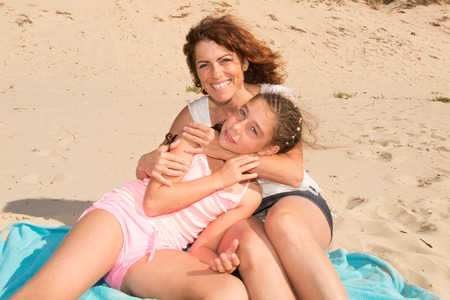 complicity: Complicity between a mother and her daughter at the beach