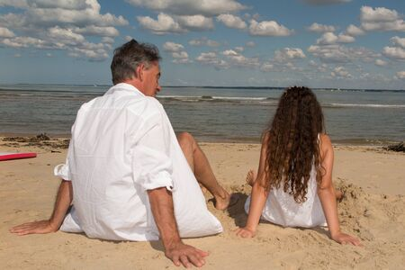 grand child: Grand father and her grand child on the beach