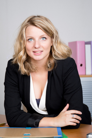 20 to 25 years old: Successful businesswoman portrait at work in bright office Stock Photo