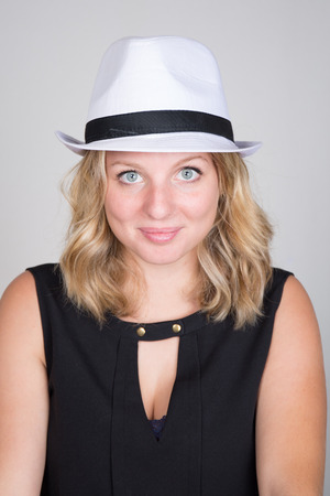 fedora: Beautiful young woman wearing summer fedora straw hat Stock Photo