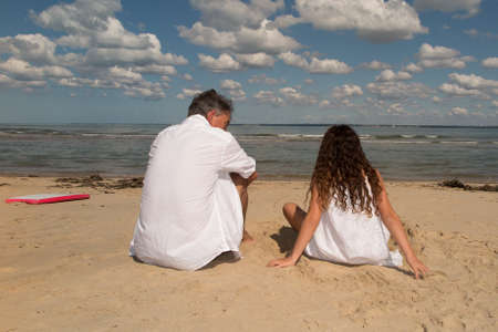 grand father: Grand father and her grand child on the beach