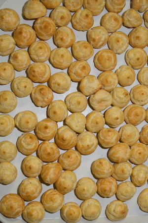 choux bun: Plate of French gougeres cheese puff choux