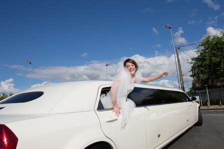 Luxury limo limousine with a bride under blue sky