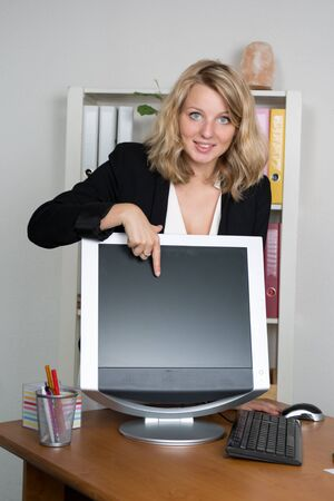 topicality: Happy business woman showing computer blank screen Stock Photo