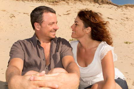 middle age couple: Middle age couple on the sand having  fun