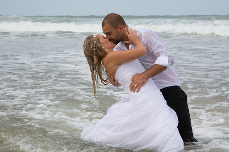 romantic date: Young newly couple happy at the beach Stock Photo