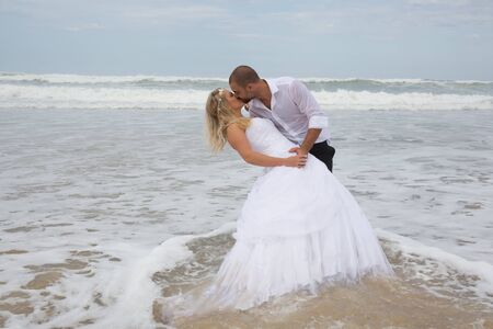 ocean and sea: Young newly couple happy at the beach Stock Photo
