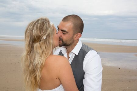 newly: Newly wedding couple at the beach in love Stock Photo