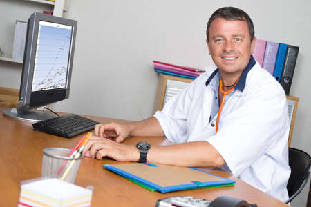 medicalcare: Portrait of handsome mature doctor in office